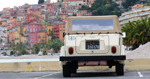 Vintage Volkswagen Thing Car With The Old Town Of Menton In The Background Archivo