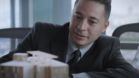 Hispanic Manager As Confident Businessman Looking At Architecture Project Mockup GIF