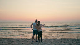 Loving Couple is Embracing and Looking at Water Sea Waves... Stock Video Footage
