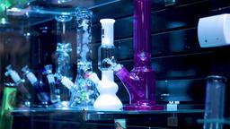 Bongs for smoking weed. Drug paraphernalia used to smoke marijuana. Display of Footage
