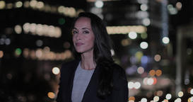 Portrait of businesswoman in city at night GIF
