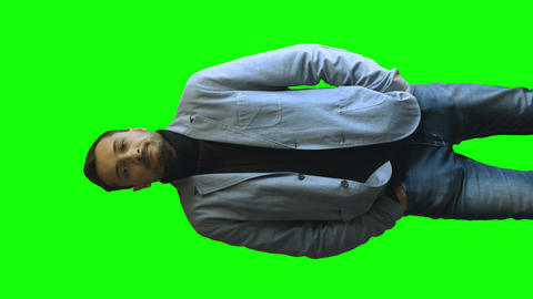a young man in a jacket smiling on green screen Footage