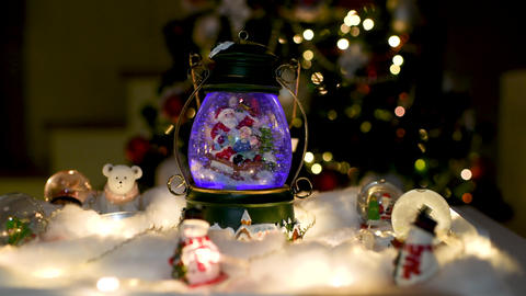 Christmas decoration, snow dome, globe with table decoration Footage