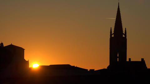 Beautiful sunrise on the steeple of the church and village of Saint Emilion, Footage