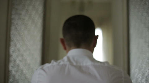 Close-up of a Man in white shirt opening white door. Man pushes the door, enters Footage