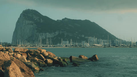 Western side of the Gibraltar Rock and docked sailboats at marina Archivo
