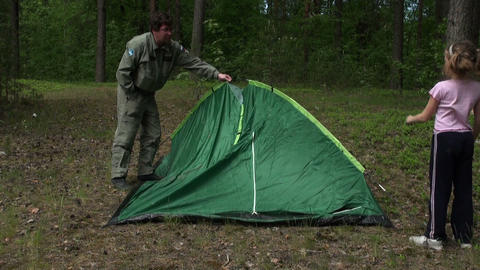 Dad with daughter put a tent Footage