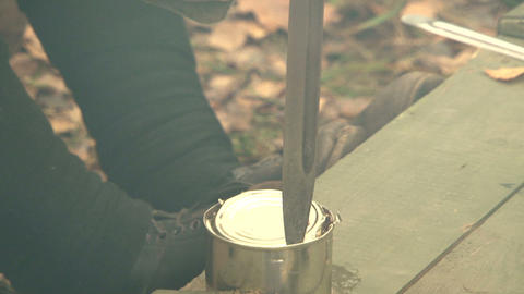 Opening a tin can with a knife Live Action