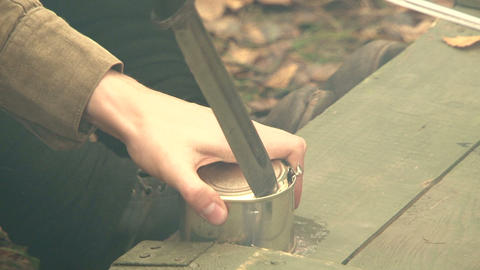 Opening a tin can with a knife Stock Video Footage