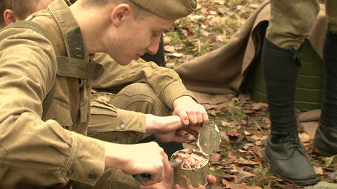 Soldiers with a knife opens canned food Footage