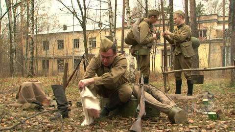 Soldiers wear boots Footage