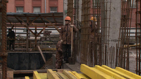 Workers at a construction site Stock Video Footage