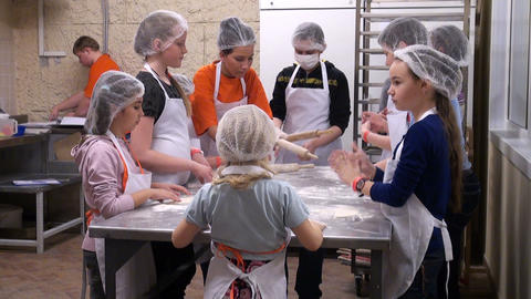 Children knead the dough Stock Video Footage