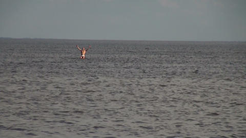 The man goes into the sea Footage