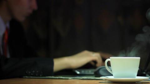 businessman works behind laptop Footage