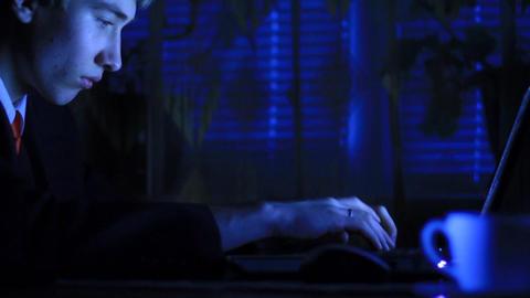 businessman works behind laptop Stock Video Footage
