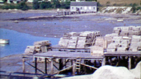 1964: Empty fishing crab traps on dock piers ready for hunting season Footage