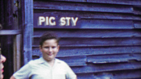 1963: Pig sty sign gets attention of immature humored pre-teen boy Live Action