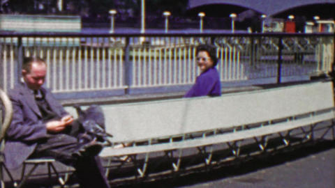 1963: Women secretly spying odd pigeon feeding businessman Footage