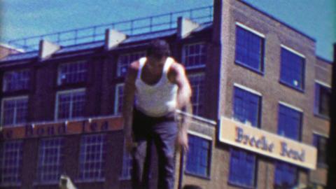 1963: Gregarious Italian merchant throwing handbag purses into crowd Footage