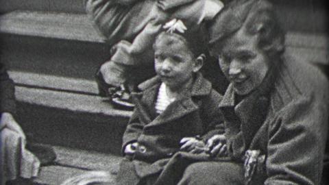 1937: Wealthy neighborhood moms entertaining kids on front stoop stairs Footage