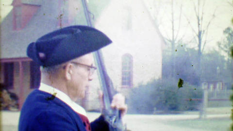 1964: Yankee doodle revolutionary era reenactor fires black powder rifle gun Footage