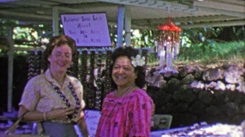 1964: Haole tourist woman Hawaiian Kukui Nut Lei from native merchant Footage