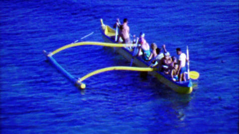 1964: Hawaiian outrigger style boat paddling in bold blue waters Footage