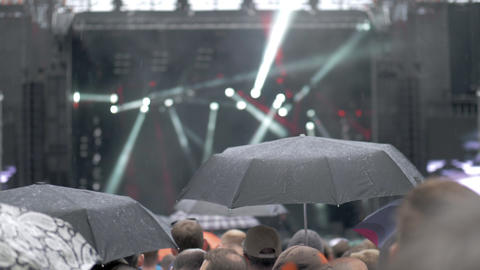 A slow motion of a rainy day at an open air concert Live Action