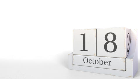Wood cube calendar shows October 18 date, 3D animation Live Action
