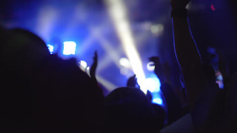 A slow motion of a crowd of fans at an evening music concert Live Action