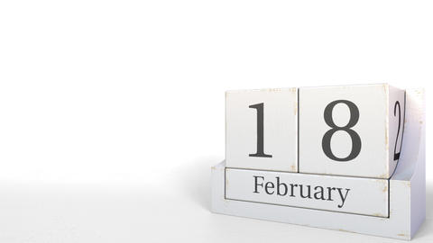 Cube calendar shows February 18 date. 3D animation Live Action