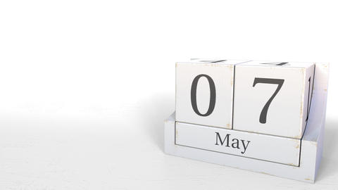 Wooden blocks calendar shows May 7 date, 3D animation Footage
