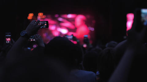 A slow motion of the crowd at an open air evening concert Footage