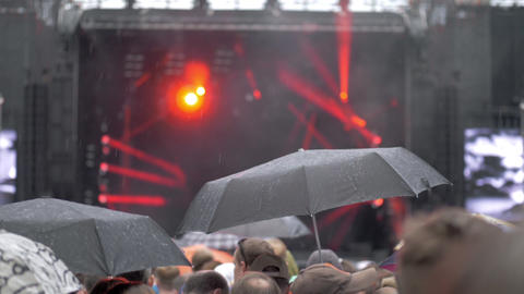 A slow motion of a rain at a concert show Live Action