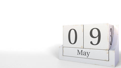 Cube calendar shows May 9 date. 3D animation Footage