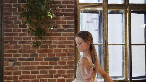 Graceful ballerina in a dress-tutu performance elements of classical ballet near Live Action