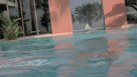 Child bathing in outdoor swimming pool. He diving and coming to the surface Archivo