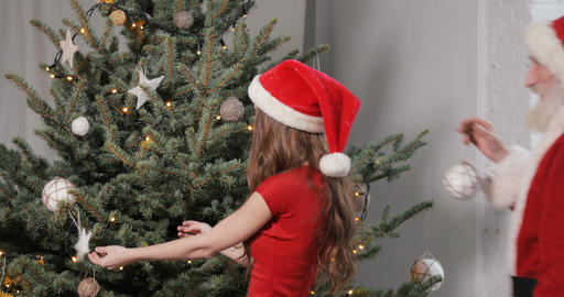 Santa Claus Helps to Decorate Christmas Tree Footage