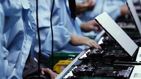 Workers Assembling Electronic Boards On a Laptop Factory Live Action