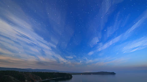 Russia, Lake Baikal, Olkhon Island, Clouds and stars on a moonlit night over GIF