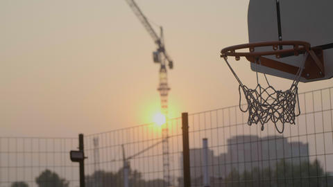 Shot of basketball slam dunk at urban sunset area Footage