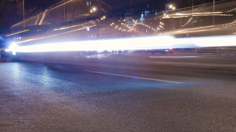 Timelapse. Evening traffic, cars quickly moving along the night street GIF