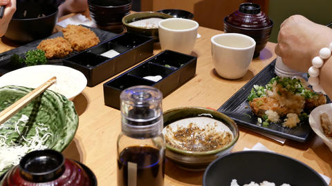 Motion of people eating food with family inside Japanese restaurant with 4k Live Action