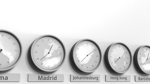 Round clock showing Johannesburg, South Africa time within world time zones Footage