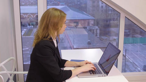 Business woman working in modern office GIF