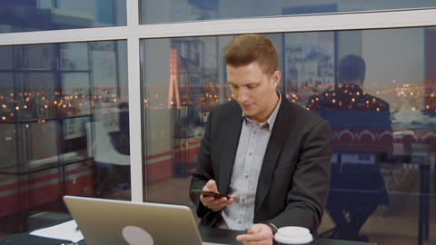Businessman reads an important message on cellphone Live Action