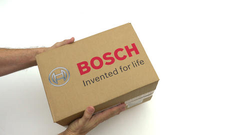 BOSCH logo on the carton in hands. Editorial clip Live Action
