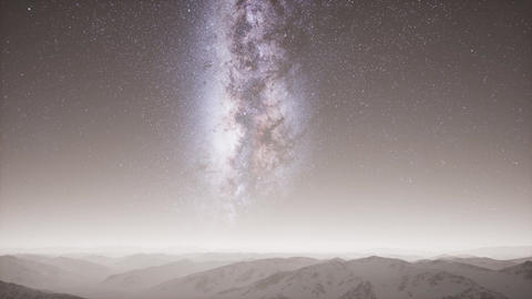 aerial view of Milky Way above snow covered terrain Live Action