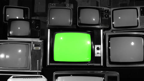 1980s Tv Green Screen With Many 1980s Tvs. Noir Tone. Dolly In Live Action